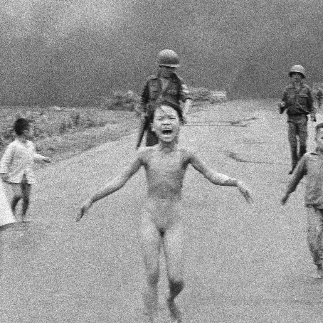 """FILE - In this June 8, 1972 file photo taken by Huynh Cong """"Nick' Ut, South Vietnamese forces follow terrified children, including 9-year-old Kim Phuc, center, as they run down Route 1 near Trang Bang after an aerial napalm attack on suspected Viet Cong hiding places. After making the photo, he set aside his camera, gave the badly burned girl water, poured more on her wounds, then loaded her and others into his AP van to take them to a hospital. When doctors refused to admit her, saying she was too badly burned to be saved, he angrily flashed his press pass. The next day, he told them, pictures of her would be displayed all over the world, along with an explanation of how the hospital refused to help. (AP Photo/Nick Ut, File) 
